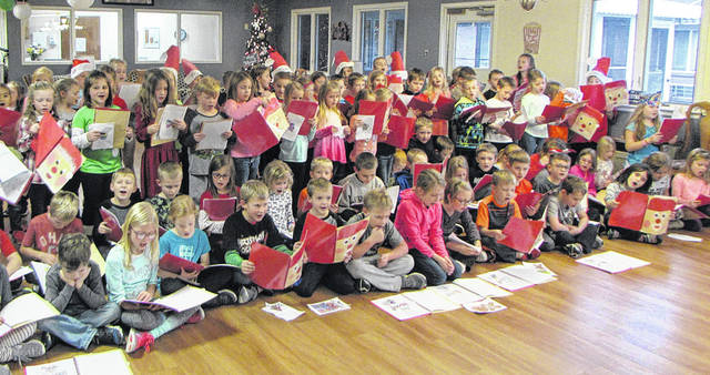 Some residents of the Versailles Health Care Center enjoyed Christmas caroling, Monday, from the Versailles Exempted Village School District's first graders.