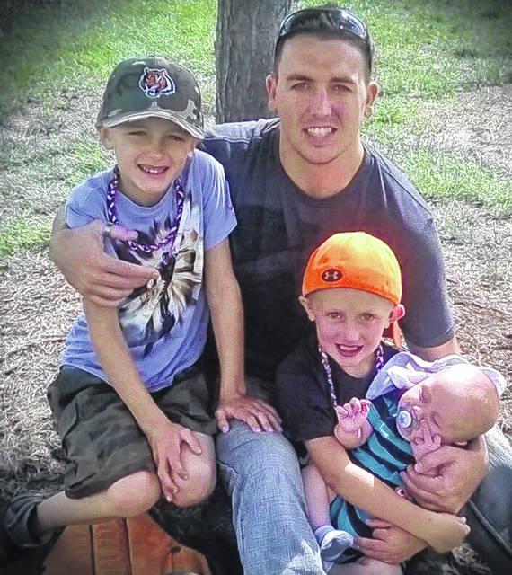 Daniel Weidle, of Germantown, died December 26, 2015, after years of battling opiate addiction. His death has lead his dad Scott on a mission to pass Daniel's Law-Ohio, that would change Ohio's current policy on opioid prescriptions. Pictured are Daniel, with his sons from youngest to oldest: Gavin, Landon and Dylan.