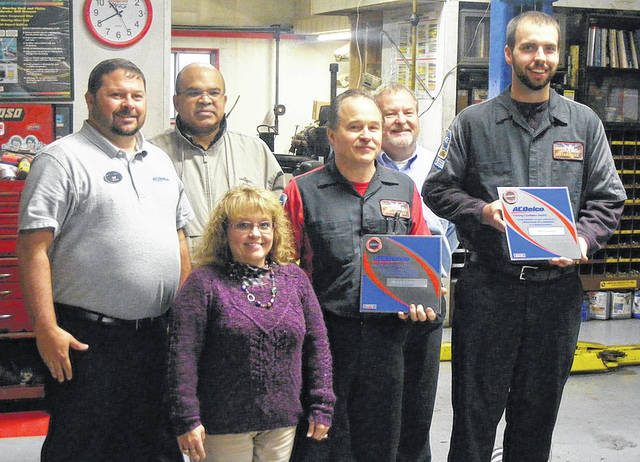 Pictured from left to right: Pat Bates, field manager After Market AC Delco, Tony Menke, regional training operations manager, AC Delco, Tracey and Thomas Besecker - owners Hi Tec Automotive; Jerry Tempel, technical training instructor, Raytheon; and Alex Ashbaugh Master Certified Tech, Hi Tec Automotive