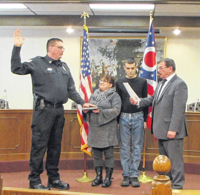 Former Greenville Police Department Detective Eric Roberts was sworn in Monday as new Operations Lieutenant. Pictured from left to right: Operations Lieutenant Eric Roberts, his wife Christy, their son Phillip and Greenville Mayor Steve Willman.