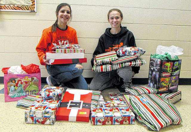 Versailles Exempted Village School District's Interact Club has teamed up with the Versailles Council of Churches to sponsor a local family for the holidays. Pictured from left to right: Interact Club seniors Treasurer Kenia McEldowney and President Kari Mangen.
