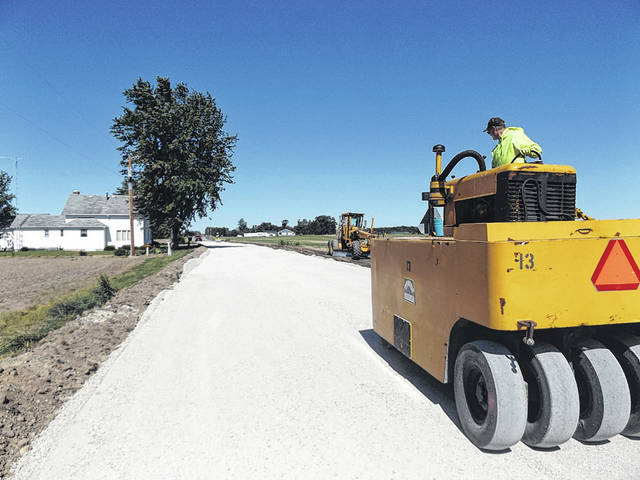 A county worker chip-seals Chase Road. Darke County spent more than $5.55 million on road and bridge work during 2017, according to County Engineer Jim Surber in his annual report.