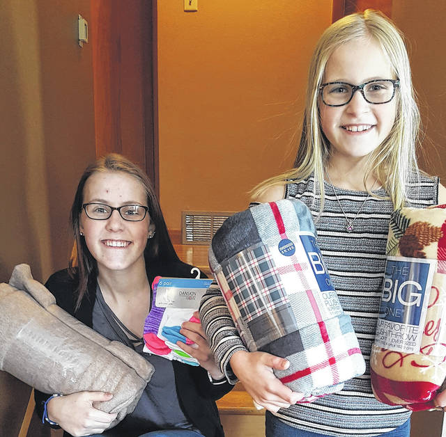 Greenville High School student Rachel Unger and her 10-year-old sister, Bridget, have partnered with local businesses to provide socks and blankets for the homeless this winter, as well as for homeless pets living in the Darke County Animal Shelter. As of Tuesday, the sisters had collected 50 blankets and 133 pairs of socks, which they've taken to the Greenville branch of Community Action Partnership (CAP), which operates Darke County's homeless shelter and provides other services for homeless individuals and families, to be distributed to those who need them.