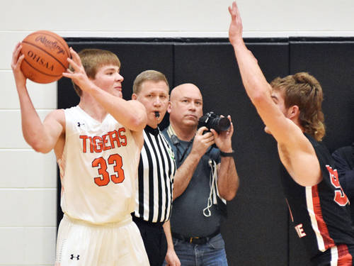 Versailles' AJ Ahrens looks to get the ball past Fort Loramie's Austin Siegel as the Versailles senior throws the ball back into play from the sideline.