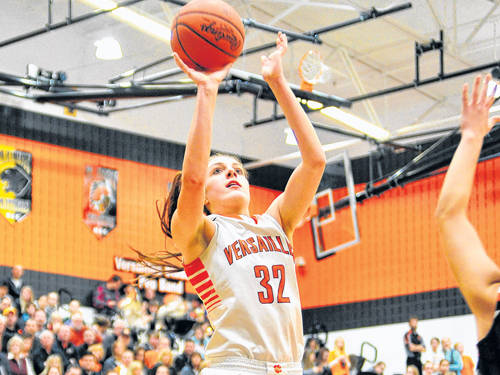 Versailles' Danielle Winner sinks a jump shot during a Midwest Athletic Conference girls basketball against Minster on Thursday in Versailles.
