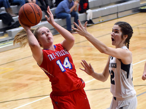 Tri-Village's Emma Printz takes a shot during a Cross County Conference girls basketball game against Covington on Thursday in Covington.