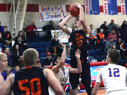 Ansonia's Hunter Muir goes up for a shot during a Cross County Conference boys basketball game against Eaton on Dec. 29 in New Madison.