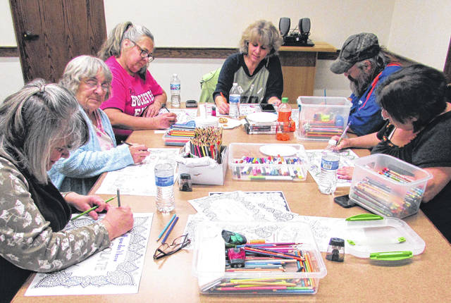 Color Crush Adult Coloring Club members talk openly about a variety of topics as they color, from the medications they're on, to the details of one member's recent surgery, to the names of various family members' new babies. The members of this group are obviously comfortable and quite familiar with each other.