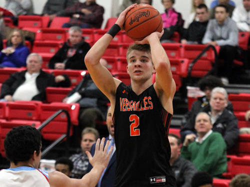Versailles' Justin Ahrens takes a shot during a boys basketball game against Lima Central Catholic on Tuesday at Lima.