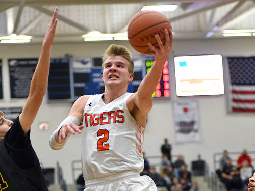 Versailles' Justin Ahrens drives to the basket during a Flyin' to the Hoop boys basketball game against Sidney on Jan. 14 at Fairmont's Trent Arena in Kettering.