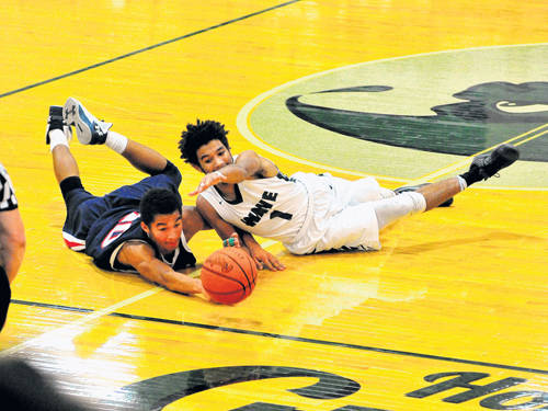 Greenville's Marcus Wood battles Piqua's Piqua's Qurri Tucker for a loose ball during a Greater Western Ohio Conference boys basketball game on Dec. 19 in Greenville.
