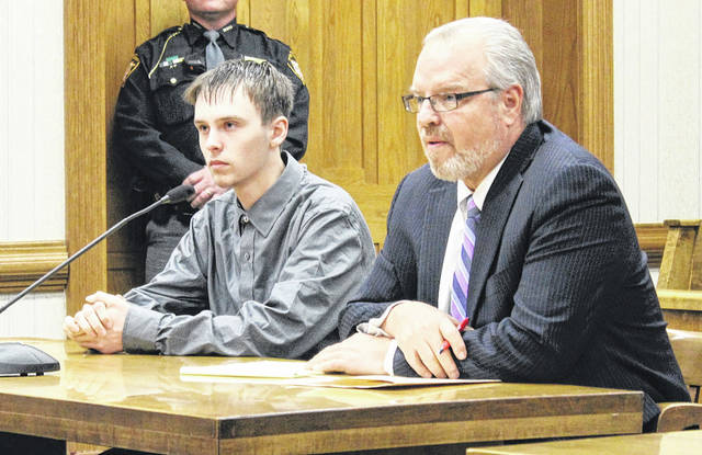 Ryan Monahan (left) listens as Judge Jonathan P. Hein announces his verdict Monday in Darke County Common Pleas Court. The Greenville teen dodged more serious charges of felonious assault, but was found guilty on one count of aggravated assault. He will be sentenced March 15.