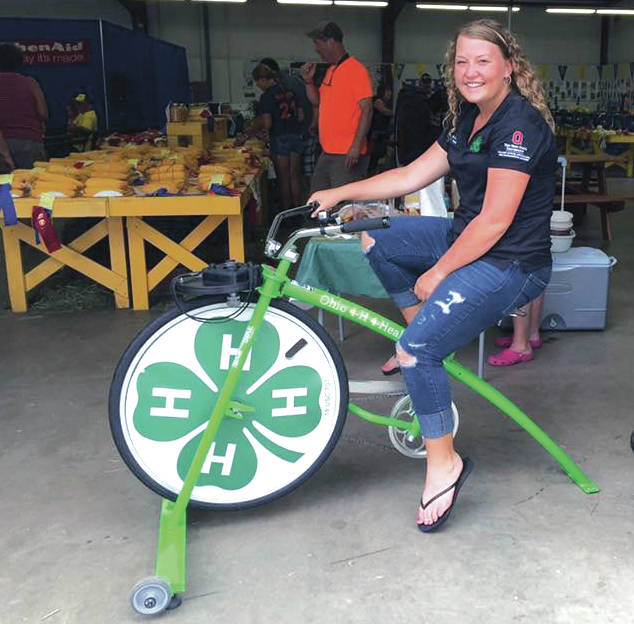 "Molly Hunt, of Greenville, was named a National 4-H Council's 4-H Youth in Action Awards Program finalist. She is pictured with the Ohio 4-H ""Smoothie Bike"", a teaching tool that is used to educate about fitness and nutrition. Molly has educated 4-Hers all around the state about healthy living, as an Ohio 4-H Health Hero."