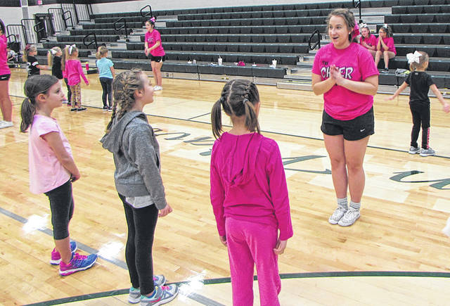 "Greenville High School (GHS) Cheerleader Alexa Snyder, a junior, helped teach the ""littles"" the cheering basics, during GHS Cheer Fun Day, Saturday."