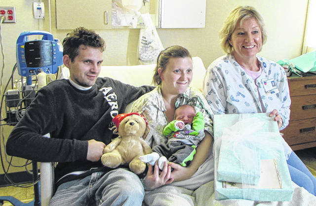 Katelyn Miron, of Greenville, gave birth to her fourth child and first boy, and first Greenville baby of the year. Zayden Joseph Neal was six pounds, seven ounces and 19 inches long. The father is Alexander Neal, also of Greenville. Pictured from left to right: Alexander, Katelyn, Zayden and delivery nurse Sharon Osterloh, RN. Osterloh is giving the family presents, from the Wayne Hospital Auxiliary and the OB Unit, in honor of having the first baby of the year.