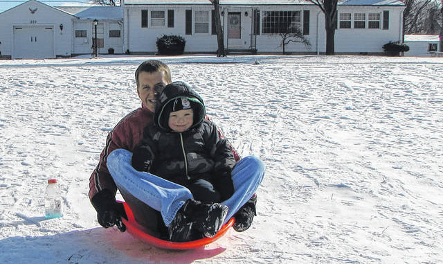 Mike Jones, of Greenville, shared some winter fun with his four-year-old son Jonathan, at Greenville City Park Sunday afternoon.