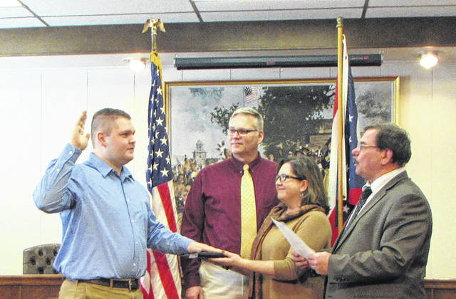 Caleb Harper, of Greenville, was sworn into the Greenville Police Department (GPD) Wednesday, by Greenville Mayor Steve Willman, with his parents Jeff and Colleen Harper by his side. Pictured from left to right: Caleb, Jeff and Colleen Harper and Mayor Willman.