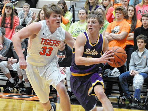 Versailles' AJ Ahrens defends Vandalia-Butlers' Kort Justice during a boys basketball game on Tuesday in Versailles.