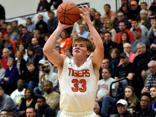 Versailles' AJ Ahrens puts up a shot during a Flyin' to the Hoop boys basketball game against Sidney on Jan. 14 at Fairmont's Trent Arena in Kettering.