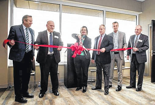 Courtesy photo Wright State President Cheryl B. Schrader cut the ribbon to officially open the Lake Campus Agriculture and Water Quality Education Center.