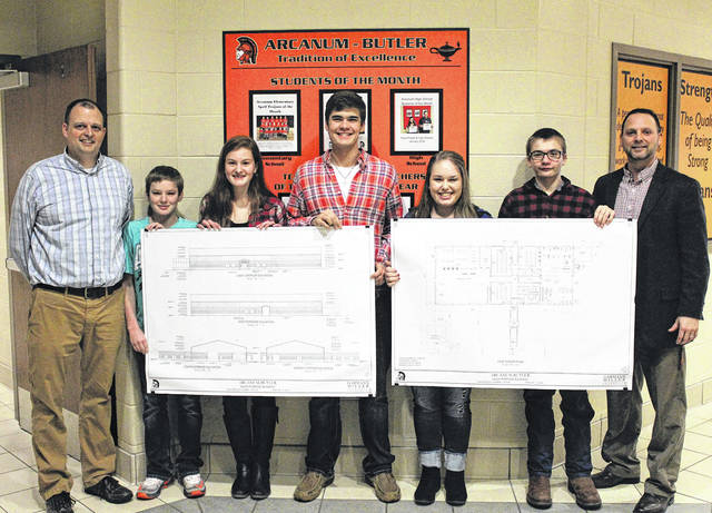 Members of the Arcanum-Butler FFA Chapter display blueprints for the school's new multi-purpose building. Shown from left are Ag Instructor/FFA Advisor Brian Pohlman, students Austin Stephens, Maggie Weiss, Zach Smith, Anna Loxley, Ray Denniston, and Superintendent John Stephens.