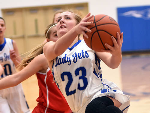 Franklin Monroe's Audrey Cable drives to the basket during a girls basketball game against Houston on Saturday in Pitsburg.