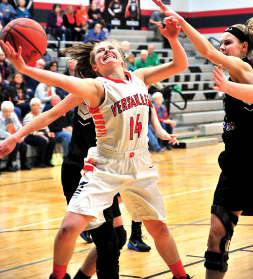 Dqi5lin MD#LEO2N3Y, 14, reaches past the Dayton Christian defense to score for the Lady Tigers
