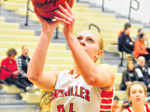 Versailles' Elizabeth Ording drives to the hoop during a Midwest Athletic Conference girls basketball game against St. Henry on Thursday in Versailles.