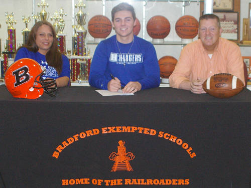 Bradford senior Hunter Penkal committed on Thursday to play football for Hillsdale College, an NCAA Division II program in Hillsdale, Michigan. Penkal is seated next to his parents, John and Angie Penkal.