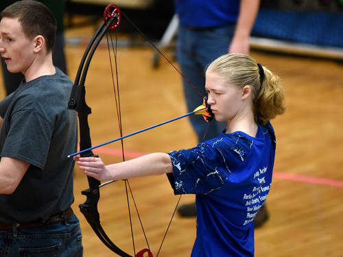 Tri-Village's Johanna Siegrist competes in an archery match against Randolph Southern on Saturday.