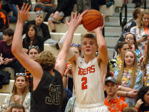 Versailles' Justin Ahrens shoots a 3-pointer during a boys basketball game against Greenville on Saturday in Versailles.