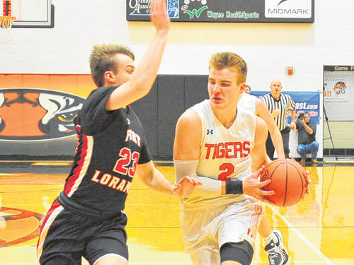 Versailles' Justin Ahrens drives to the hoop as Evan Berning of Fort Loramie defends during a boys basketball game on Jan. 9 in Versailles.