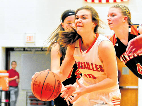 Versailles' Kami McEldowney has her eye on the basket during a Midwest Athletic Conference girls basketball game against Minster on Jan. 25 in Versailles.