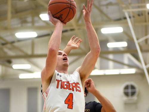 Versailles' Keaton McEldowney goes up for a shot during a Flyin' to the Hoop boys basketball game against Sidney on Jan. 14 at Fairmont's Trent Arena in Kettering.
