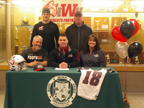 Greenville senior Landin Brown committed to play football for Indiana Wesleyan University on Wednesday. Pictured are (front row, l-r) father Mart Brown, Brown, mother Kathy Brown, (back row, l-r) brother Justin Brown and brother Shawn McGuire.