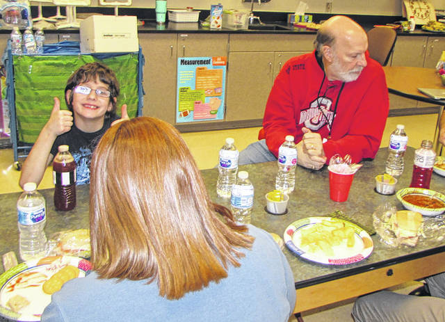 Bradford Exempted Village Schools Intervention Specialist Tina Schmitz' students invited guests to a Super Bowl Party, Friday. Students and staff are pictured enjoying soups and sandwiches, prepared by the students and Schmitz.