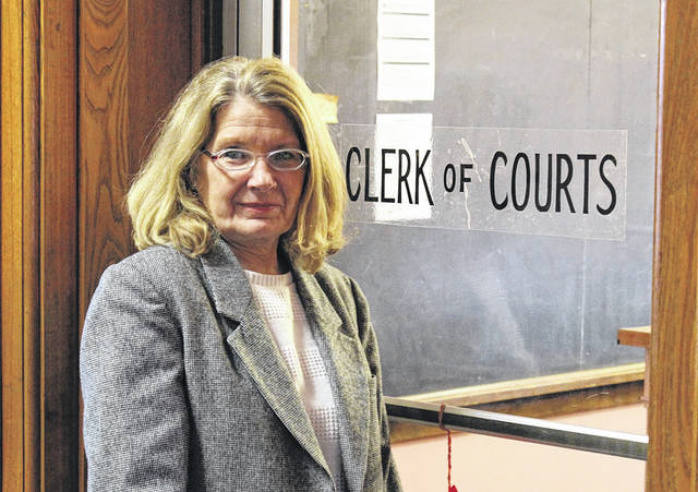 Darke County Clerk of Courts Cindy Pike stands outside her office at the Darke County Courthouse. Pike was first elected to the position in 1996.