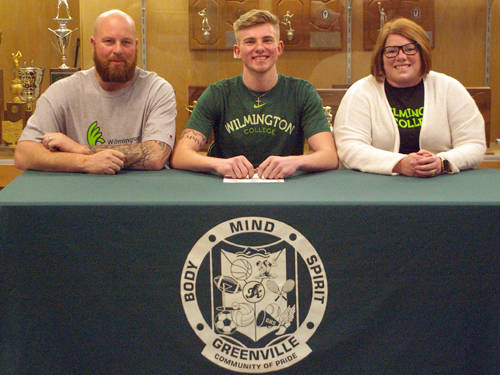 Greenville senior Ethan Emrick committed to the Wilmington College football team on Wednesday. He is pictured next to his father Kent Emrick (left) and mother Candice Emrick (right).