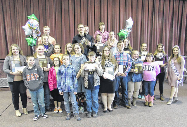 Members of 4-H clubs Ansonia Animal, Blue Angels, Canine Capers, Darke County Holstein, Friendly Farmers, Genesis, Jackson Friendship, Joyful Jets, Patterson Patchers, Silver Hoofs, Versailles Busy Beavers, and Darke County Beef, winners of the 4-H Honors Club Gold Award.