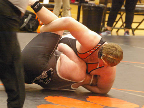 Versailles' Jeffrey Ware wrestles Covington's Bryce Keiser in an Ohio High School Athletic Association dual team match on Jan. 31 in Versailles.