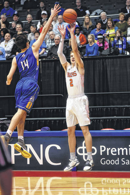 Versailles' Justin Ahrens puts up a shot during an Ohio High School Athletic Association district championship boys basketball game against Madeira on Wednesday at the University of Dayton.