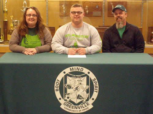 Greenville senior Kaleb Anderson committed to play football for Wilmington College on Wednesday. He is pictured with his mother Kelly Anderson (left) and father Corby Anderson (right).