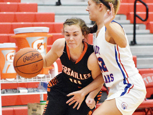 Versailles' Kami McEldowney drives during the first half of the District 9 Division I-II-III girls all-star game on Thursday at Troy's Trojan Activities Center.