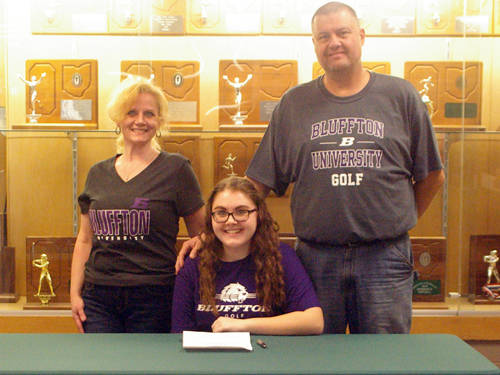 Greenville senior Kourtney Kretschmar committed to golf at Bluffton University on Wednesday. She is pictured with her mother Kayann Kretschmar (left) and father Keith Kretschmar (right).
