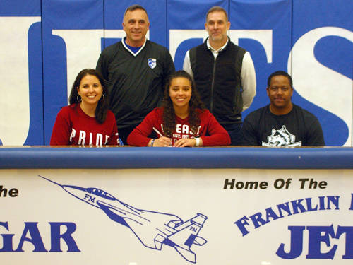 Franklin Monroe senior Nychelle Cool signed her letter of intent Wednesday afternoon to play for the Indiana University East women's soccer team. Pictured are (front row, l-r) mother Danyelle Cool, Nychelle Cool, father John Johnson, (back row, l-r) Franklin Monroe soccer coach Danny Diceanu and IU East women's soccer coach Shane Meridith.