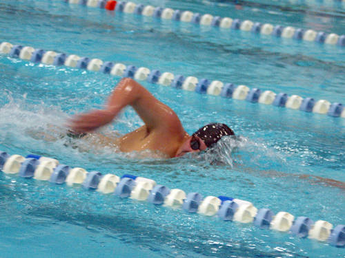 Greenville's Pablo Badell swims during a meet on Dec. 15 at the YMCA of Darke County in Greenville.