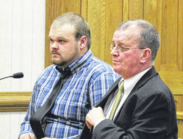 Samuel Poeppelman (left, with defense attorney Kevin Lennen) was sentenced to four years in prison after pleading guilty to attempted rape.