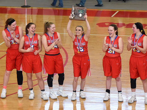 Tri-Village's Kayla Burke holds up the Lady Patriots' district championship trophy following a win against Russia on Saturday in Troy.