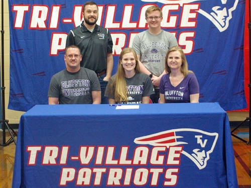 Tri-Village senior Alana Holsapple committed to the Bluffton University volleyball team on Thursday afternoon. Pictured are (front row, l-r) father Dick Holsapple, Alana Holsapple, mother Pam Holsapple, (back row, l-r) Tri-Village volleyball coach Chris Brewer and brother Dylan Holsapple.