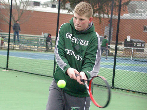 Greenville's Bryan Day returns a shot during a boys tennis match against Northmont on April 6 in Greenville.